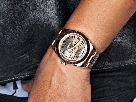 Chrissy's watch is golden.