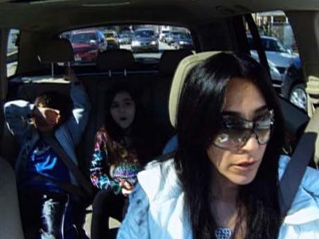 Carla and the kids on the way to pick up Joe from prison