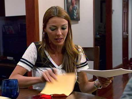 Drita signs the divorce papers.