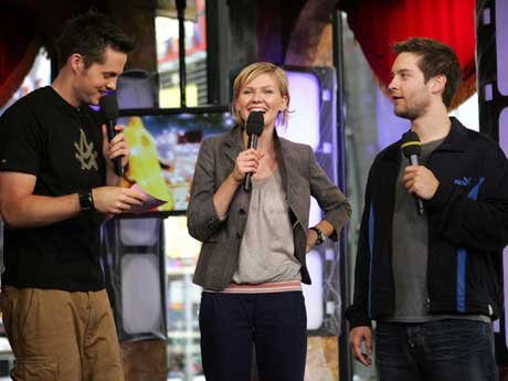 Spider-Man 2 stars actors Kirsten Dunst (C) and Tobey Maguire (R) appear on stage with MTV VJ Damien Fahey during MTV TRL Times Square Film Festival Week at the MTV Times Square Studios June 29, 2004 in New York City. [Getty Images]