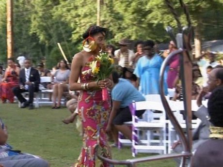 Here comes the bride. Inez walks down the aisle.
