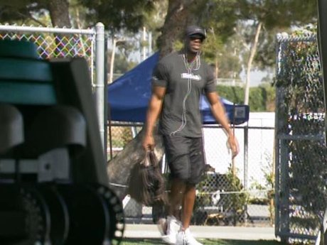 T.O. gets ready to hit the field. It's go time.