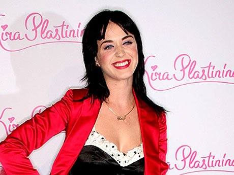 2008: This high-waisted one-piece with polka dot accents flaunts Katy's gorgeous hour-glass figure and shows she can work the classic pin-up look like no other. By topping the black and white combo off with a red bedroom blazer, Katy launches herself into
