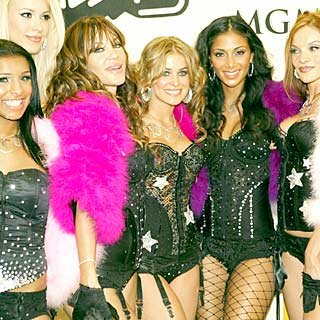 Carmen Electra poses with cabaret act The Pussycat Dolls. credit: Frank Micelotta/Getty Images